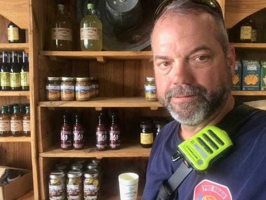 Steve Richardson at SweetCreek with his bottled sauce in the background.