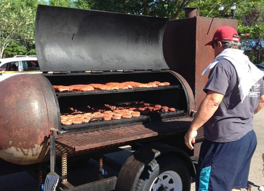 Associate Pastor Steve Richardson works the grill.