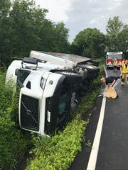 An overturned tractor trailer has caused a 60-gallon diesel spill in a stream by Swamp Leanna Road.