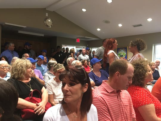 Residents were lined up around the building waiting to get into the Ridgetop BOMA meeting where the board plans to discuss the police department Tuesday night.