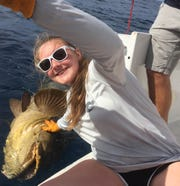 Recent Page High graduate Abby Kelly, who will be a freshman at MTSU in the fall, caught this 200-pound Goliath grouper off the shore of Sarasota, Florida.