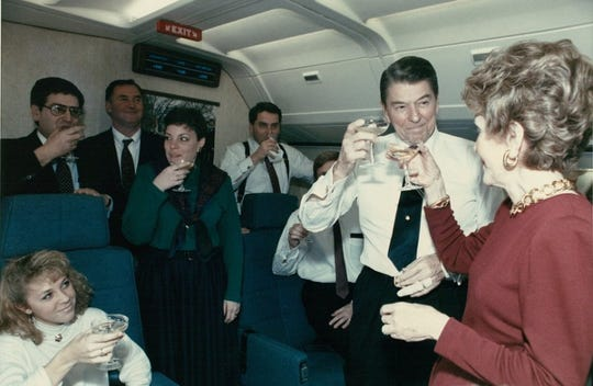Howie Franklin (standing second from left), who served as a crewmember on Air Force One, watches as President Ronald Reagan toasts with his wife, Nancy. Franklin is the only flight steward who's worked for five U.S. Presidents: Gerald Ford, Jimmy Carter, Reagan, George H. W. Bush and Bill Clinton. Franklin spoke at the Naples Airport on Wednesday, July 3, 2019.