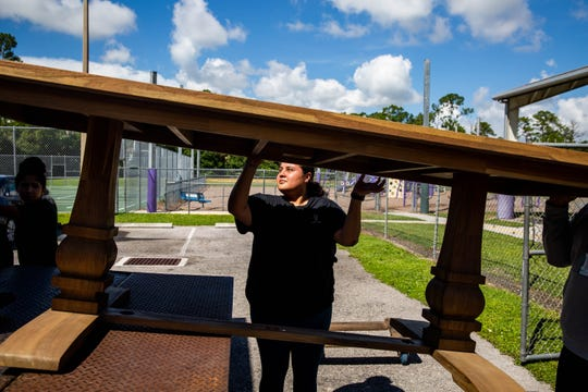 Samantha Aguilar of the Benison Center delivers furniture to Village Oaks Elementary School in Immokalee on Tuesday July 2, 2019.