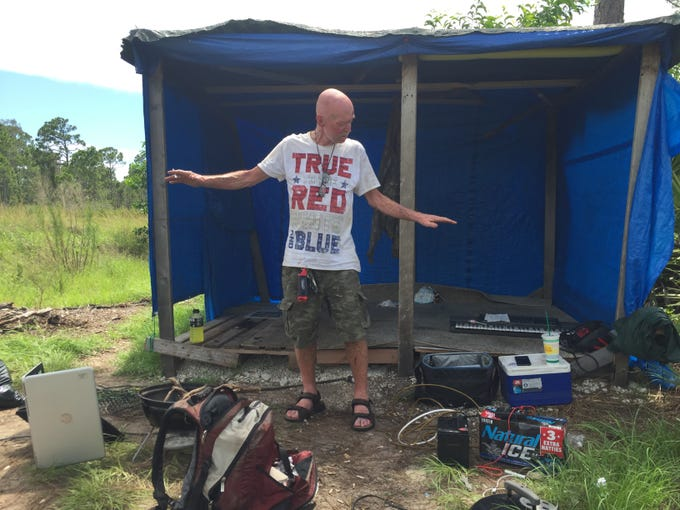 Keith Crane takes inventory of his homeless camp in south Lee County, before it was torn down on July 1, 2019, by junk haulers hired by the property owner. Crane has been looking to get off the streets, but the local shelters are full.