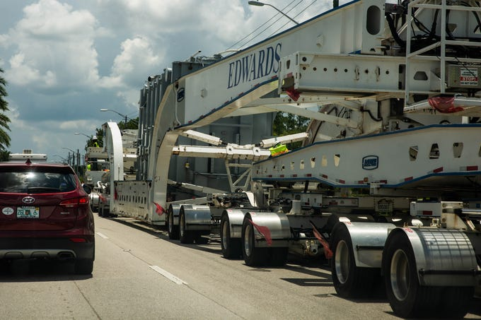 A transformer is transported to its substation on Collier Boulevard near 15th Avenue SW in Naples on July 3, 2019. The shipment is approximately 300-feet long, 16-feet wide and 17-feet high and was escorted by law enforcement.