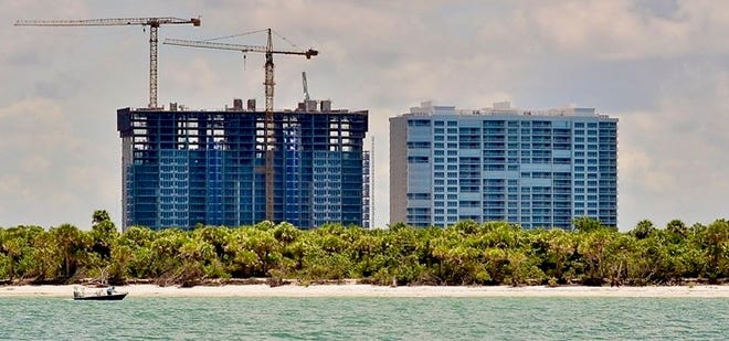 The second tower at Kalea Bay (left) is scheduled to celebrate its topping off early this summer.