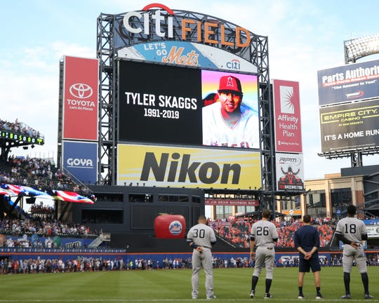 Jul 2, 2019; New York City, NY, USA; the New York Mets and the New York Yankees observe a moment of silence for deceased Los Angeles Angels pitcher Tyler Skaggs before a game at Citi Field.