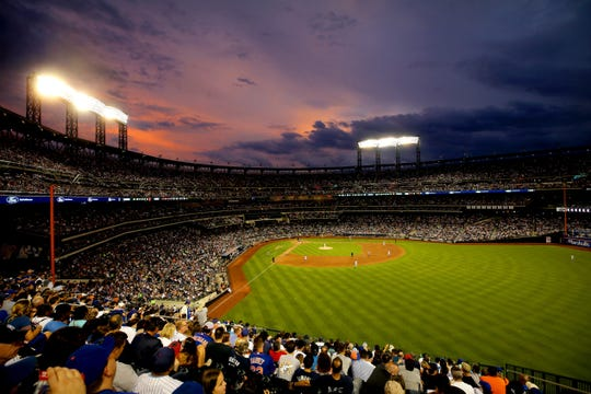 Jul 2, 2019; New York City, NY, USA; General view of sunset behind Citi Field during the fifth inning between the New York Mets and the New York Yankees.