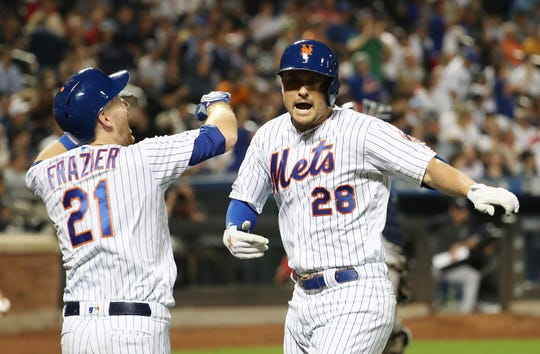 J.D. Davis #28 of the New York Mets celebrates his sixth inning solo home run against the New York Yankees during their game at Citi Field on July 2, 2019 in New York City.