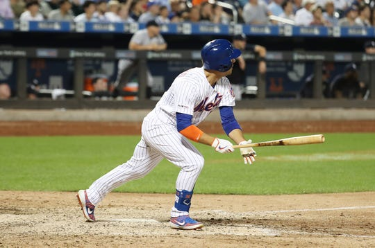Michael Conforto #30 of the New York Mets drives in two runs in the eighth inning with a double against the New York Yankees during their game at Citi Field on July 2, 2019 in New York City.
