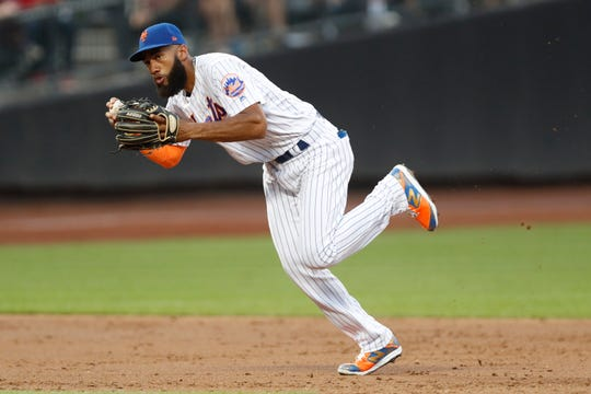 New York Mets' shortstop Amed Rosario makes a play on Aaron Judge's groundout during the third inning of an interleague baseball game against the New York Yankees, Tuesday, July 2, 2019, in New York.