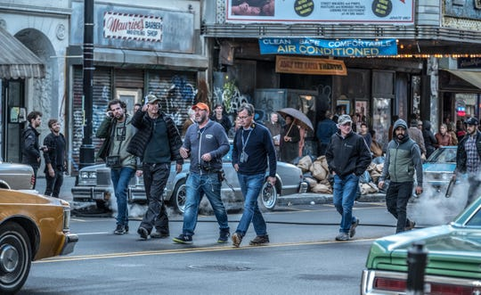 "Lawrence Sher (center, in orange cap)  filming ""The Joker"" in Jersey City"