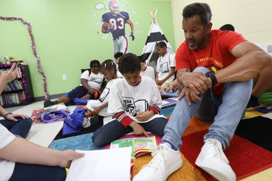 Pro Football Hall of Famer, Andre Reed, is shown with youngsters in the new reading room at the Boys & Girls  Club of Passaic. Wednesday, July 3, 2019
