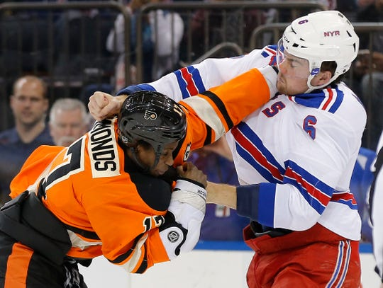 Philadelphia Flyers right wing Wayne Simmonds (17) fights with New York Rangers defenseman Dylan McIlrath (6) during the first period of an NHL hockey game, Sunday, Feb. 14, 2016, in New York.