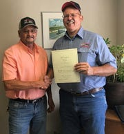 Randahl Mills, CAST Specialty Transportation Carlsbad terminal manager, left, presents Mark Beene with an award for 20 years of service with CAST and EM's Waste Isolation Pilot Plant.