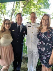 Andrew Lang, center right, celebrating with family after his graduation from the U.S. Merchant Marine Academy.