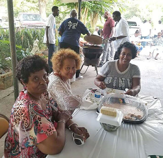 Friends, relatives and Opelousas residents attend the grand re-opening of Thomas Catering, a well-known catering service in St. Landry Parish. The business was founded by the late Lucille Thomas.