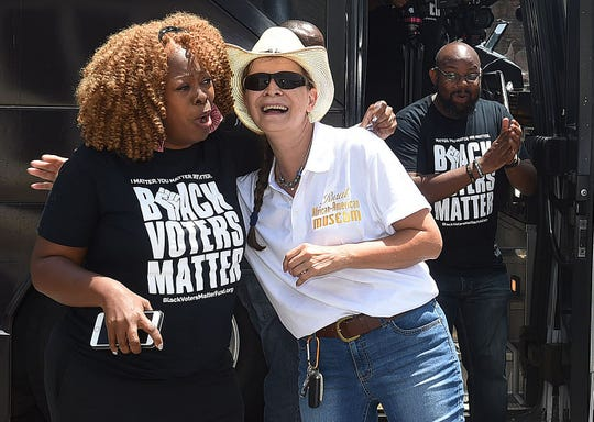 Black Voters Matter co-founde rLaTosha Brown, left, is welcomed by Agnes Courville as the Black Voters Matter bus tour arrives in Opelousas Monday afternoon.