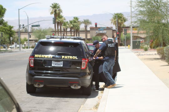 California Highway Patrol officers converged along with Riverside County sheriff's deputies at the Desert Oasis Apartments in Palm Desert, where they searched for and found a suspect, on Wednesday, July 3, 2019.