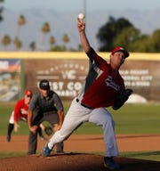 Palm Springs Power pitcher Justin Watland pitches against the OC Legends on July 2, 2019.