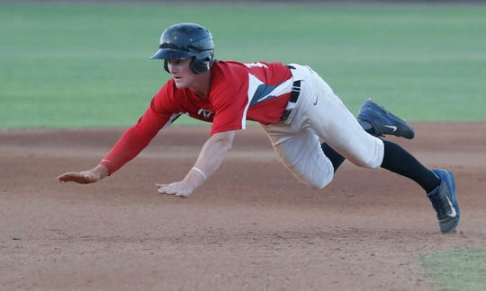 Palm Springs Power player slides into third base against the OC Legends on July 2, 2019.