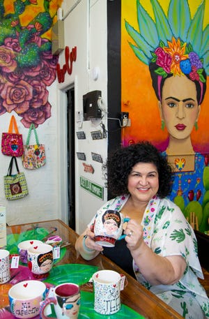 """Kathy Cano-Murillo, aka the Crafty Chica, wrote """"Forever Frida,"""" celebrating Mexican painter Frida Kahlo. She sells her work at Mucho Mas Art Studio in Phoenix."""