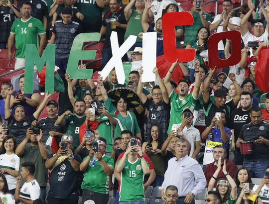 Mexico soccer fans cheer on their team during warmups  before the Concacaf Gold Cup match between Mexico and Haiti at State Farm Stadium in Glendale July 2, 2019.