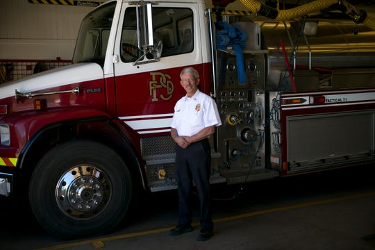 Pine-Strawberry Fire Chief Gary Morris stands in front of one of the agency's two fire engines.