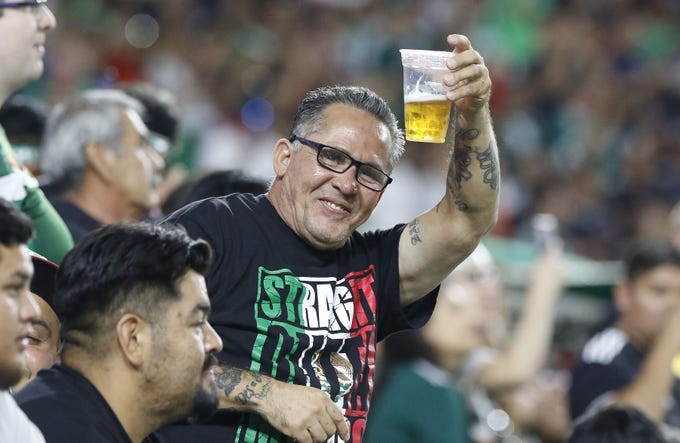 A Mexico fan salutes his buddies before the start their Concacaf Gold Cup match game with Haiti at State Farm Stadium in Glendale July 2, 2019. (Darryl Webb/For the Republic)