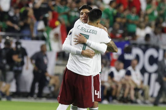 Mexico's Carlos Salcedo (3) and Edson Alvarez (4) hug before their match  their Concacaf Gold Cup match game with Haiti at State Farm Stadium in Glendale July 2, 2019. (Darryl Webb/For the Republic)