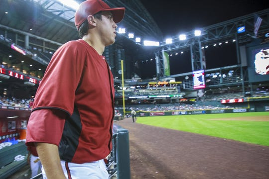 Tyler Skaggs leaves the Diamondbacks dugout at Chase Field during an exhibition game in 2012.