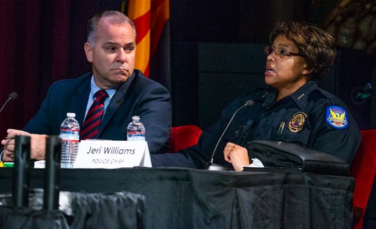 Phoenix City Manager Ed Zuercher (left) listens as Phoenix Police Chief Jeri Williams makes a point during a Phoenix City Council meeting at the Orpheum Theatre in downtown Phoenix, July 2, 2019.