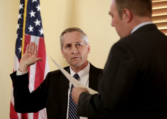 Newly appointed Arizona Supreme Court Justice Andrew Gould is sworn in by Assistant Arizona Secretary of State Lee Miller on Dec. 19, 2016, at the Capitol in Phoenix.