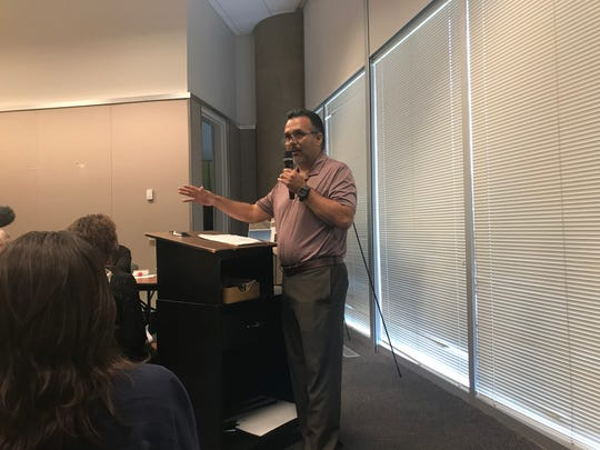 Carlos Avila, representing a neighborhood association, voiced opposition to the opening of a migrant shelter at a shuttered school.