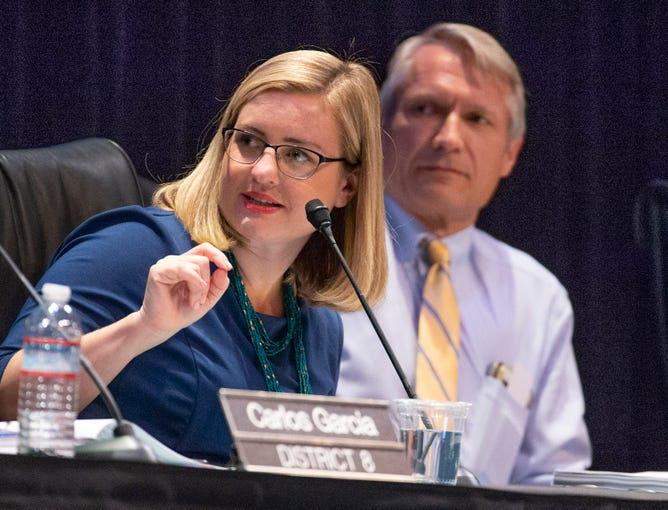 Mayor Kate Gallego calls on Councilman Sal Dicicio as the Phoenix City Council conducts a meeting at the Orpheum Theatre in downtown Phoenix, July 2, 2019. Vice Mayor Jim Waring (right) listens.