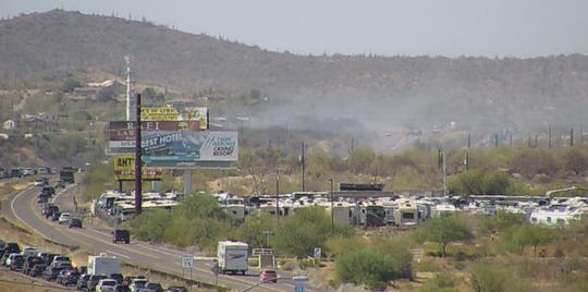 A brush fire caused traffic jams and closed a stretch of the Interstate 17 north of Phoenix on July 3, 2019.