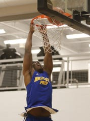 Hillcrest Prep North's Michael Rogers dunks during a warmup before a game against Taylor Made Prep at North Valley Christian Academy in Phoenix, Ariz. on December 3, 2018.