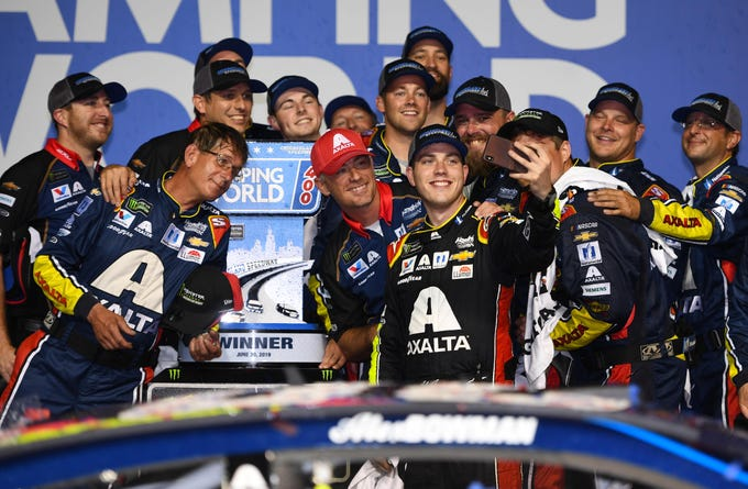 Jun 30, 2019; Joliet, IL, USA; NASCAR Cup Series driver Alex Bowman (88) takes a selfie after winning the Camping World 400 at Chicagoland Speedway. Mandatory Credit: Mike DiNovo-USA TODAY Sports