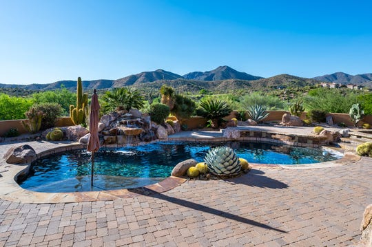 The $2.45M Scottsdale mansion purchased by Charles Hood and Marianne Zychal features a backyard that offers mountain views.