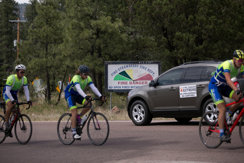 Bikers pass through the main road in Pine, Ariz., on June 25, 2019.