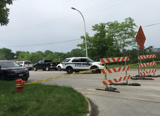 CN police remain at the scene of Friday morning's train derailment in the international tunnel beneath the St. Clair River. Both 10th and 16th streets remain closed between Cedar and Beard streets in Port Huron.