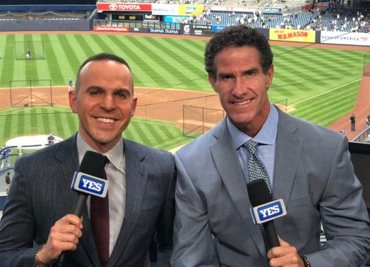 Fishkill native Ryan Ruocco is photographed in the Yankee Stadium press box alongside Paul O'Neill.