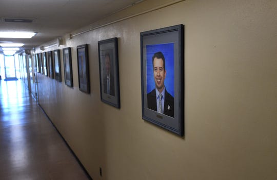 A wall with portraits of past superintendents is seen in a hallway of the Washoe County School District headquarters in Reno on July 2, 2019. The last photo in the row is of past Superintendent Pedro Martinez.