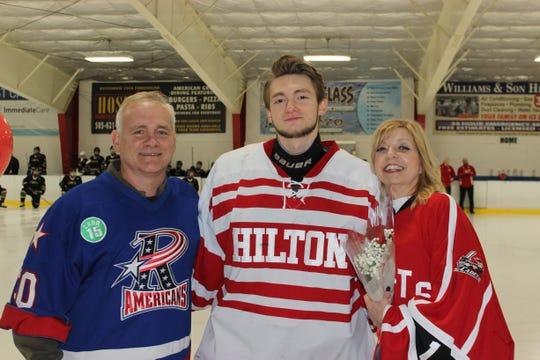 Senior Night: Dad, son, mom and memories.