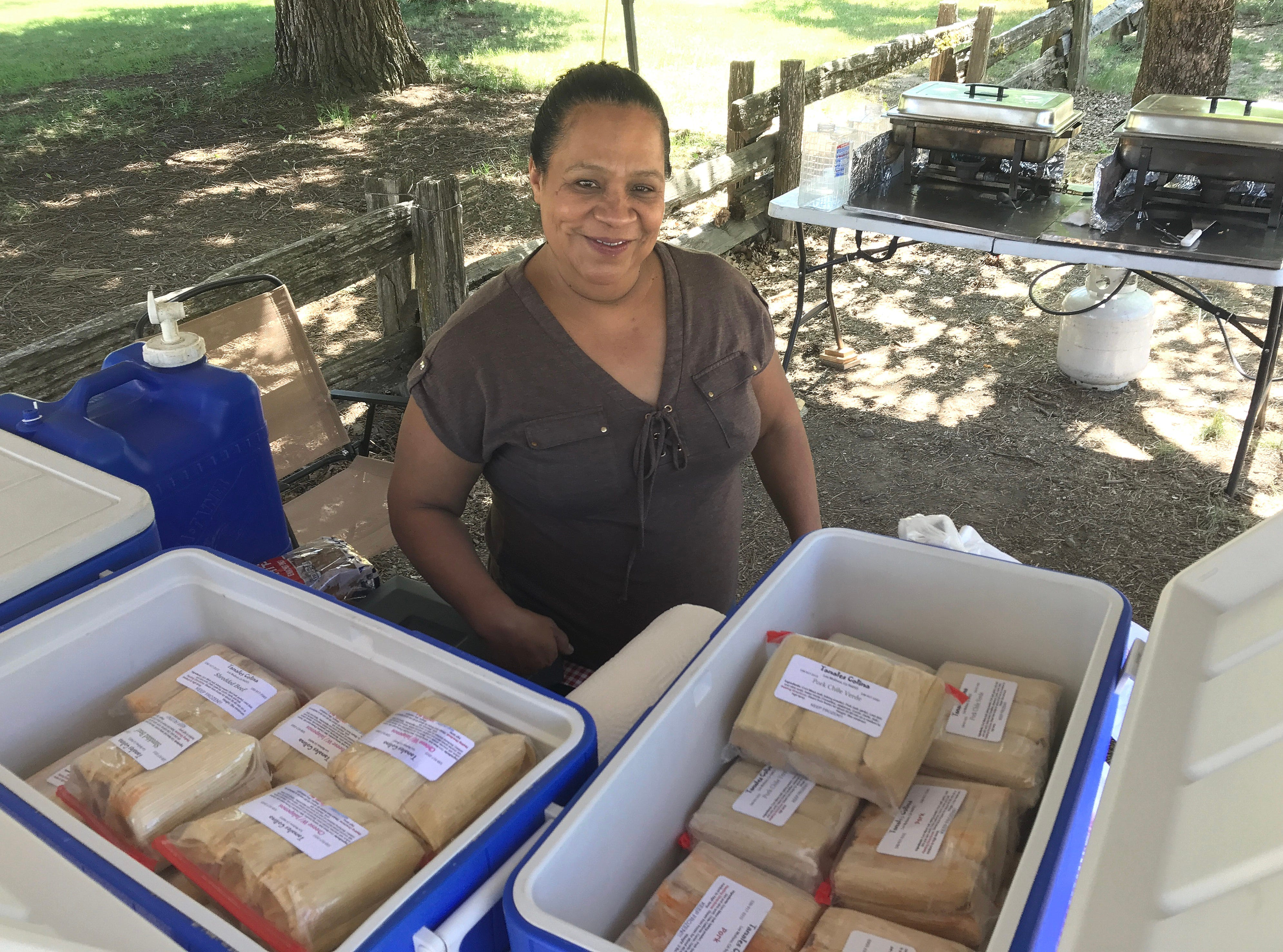 Cristina Contreras sells tamales from a roadside stand along Highway 3 in front of Hayfork Park on Tuesday, July 2, 2019.