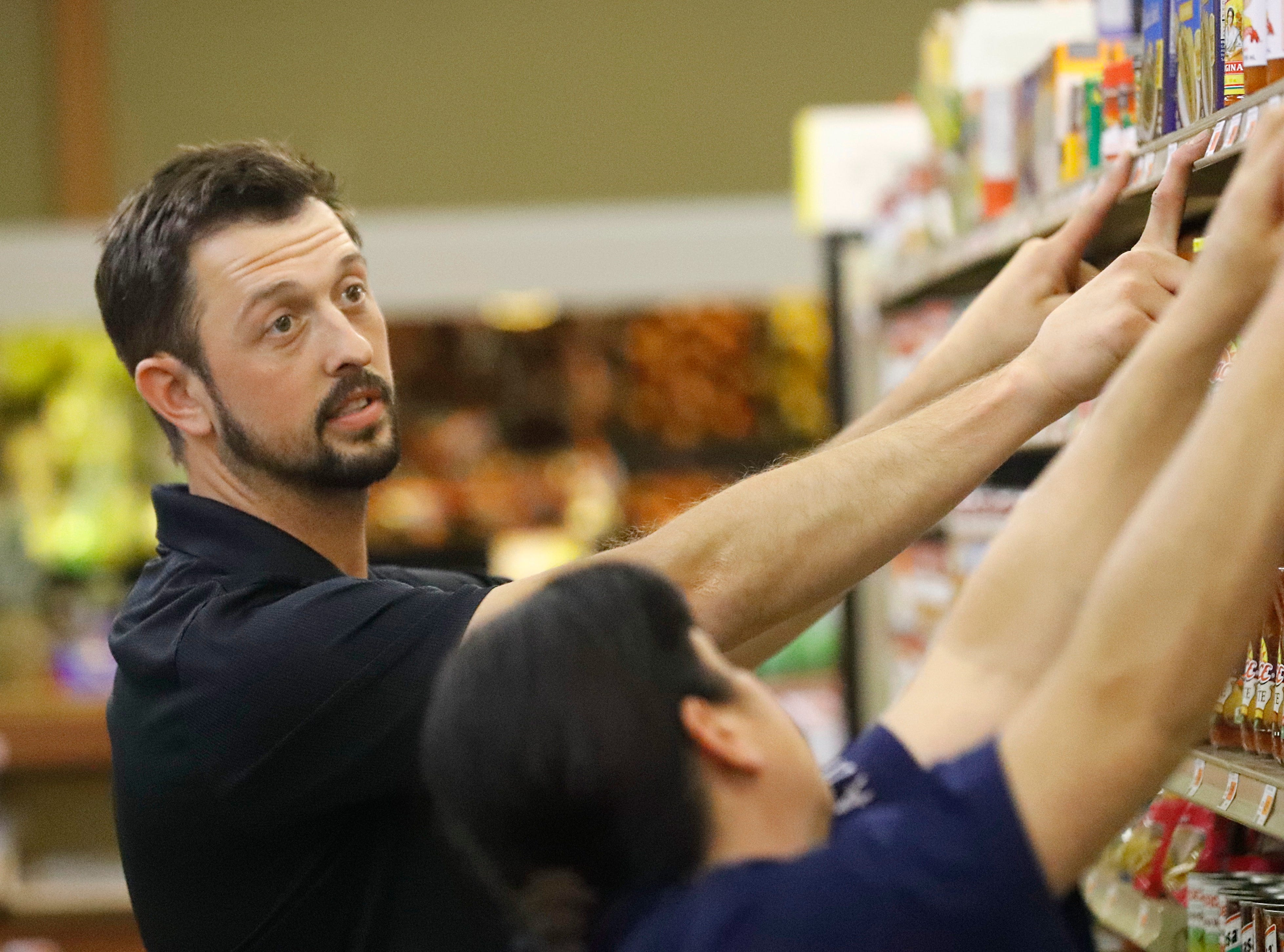 """Kenny """"K.J."""" Wiley helps an employee rearrange a shelf of salsa and rice at the store that's been in his family for 57 years along Highway 3 in Hayfork on Tuesday, July 2, 2019. Wiley said residents in the Hayfork area are constantly concerned about wildfire."""
