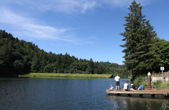 Families gather on the dock during free fishing day on Saturday, June 4, 2016, at the Silverton Reservoir.