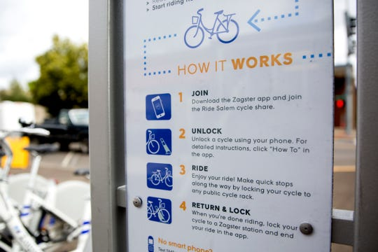 Instructions on how to use Ride Salem's bike share station are shown next to the bicycles at the corner of Chemeketa and Church Streets NE in downtown Salem on July 3, 2019.