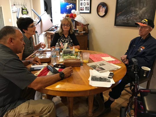 At his daughter's Salinas home, Lonnie Cook (far right) shares his experience in World War II on June 10, 2019.