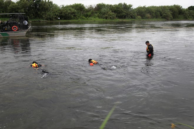 A U.S. Border Patrol dive team searches for a missing 2-year-old girl in the Rio Grande near Del Rio, Texas. The girl's mother told agents the toddler went missing while they were crossing the river from Mexico on July 1, 2019.